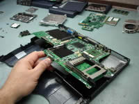 Toshiba Satellite 1200. Lift up laptop system board.